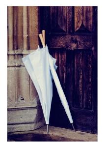 White umbrellas against the door